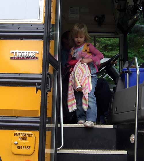 alex getting off her first school bus ride